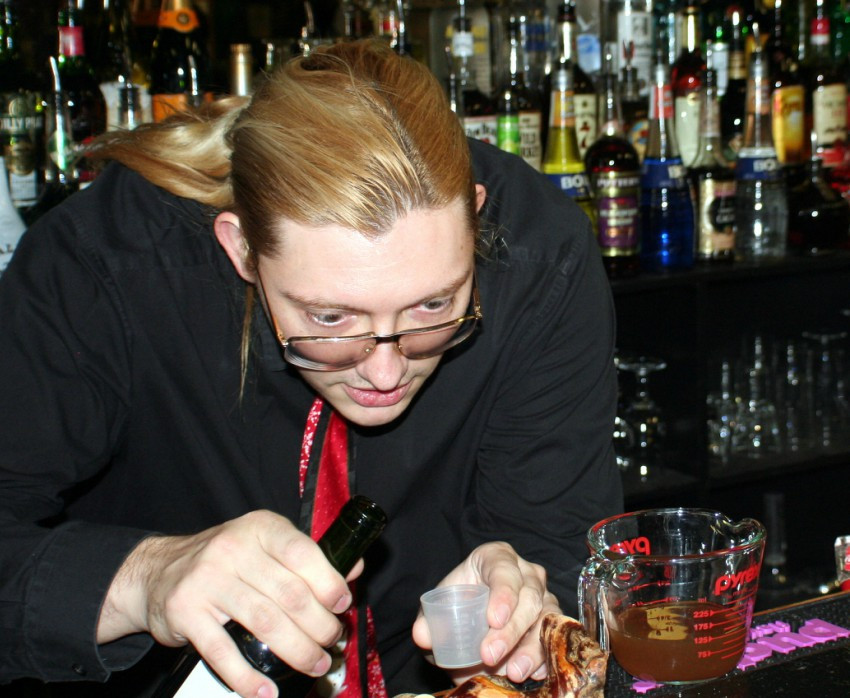 A Crescent mixology student concentrates while working in the bar